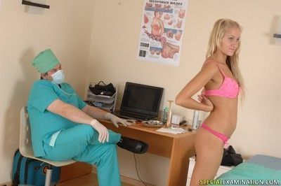 Sexy blonde babe with male doctor