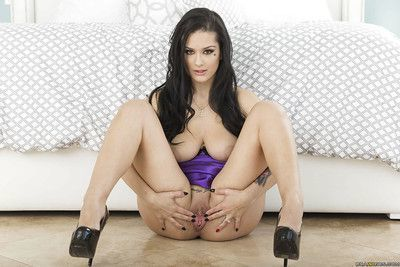 Sultry Katrina Jade spreading her legs for a look at her shaved kitty