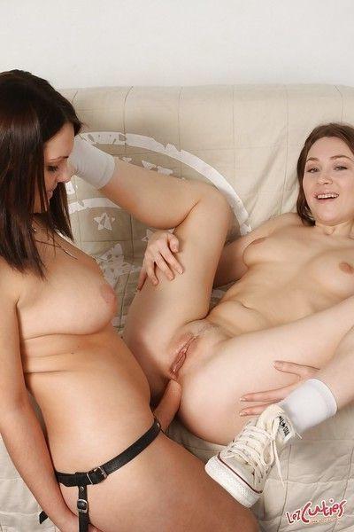 Horny teenage chicks have a lesbian sex using a strapon dildo