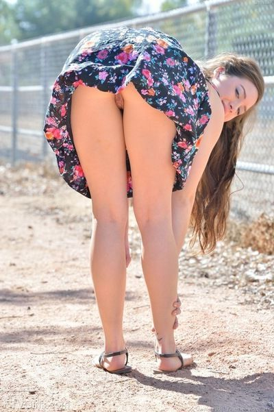 Young teen spreads ass for naked upskirt & toys pussy outdoors