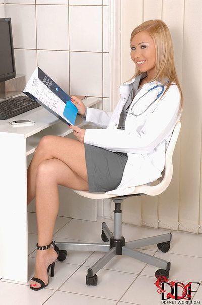 Naughty nurse Jessy Brown giving blowjob at gloryhole sperm bank