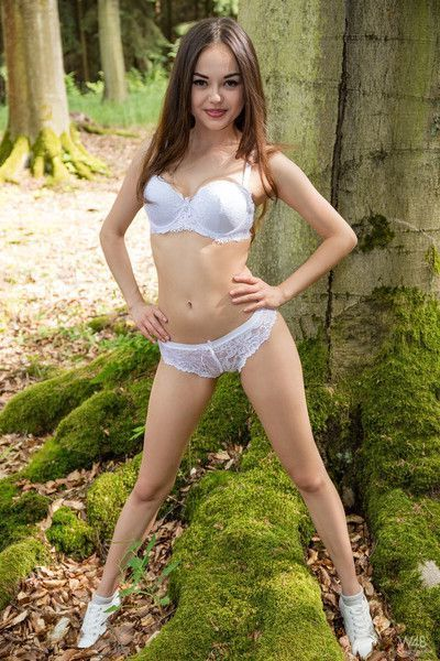 Delectable asian teen li moon gets naked in the forest