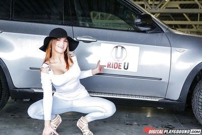 Redhead solo girl Barbara Bieber exposing large tits outdoors in floppy hat