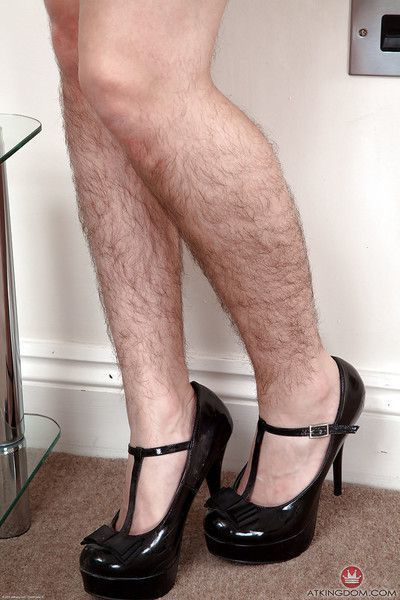 Leggy mature lady in high heels and skirt showing off really hairy legs