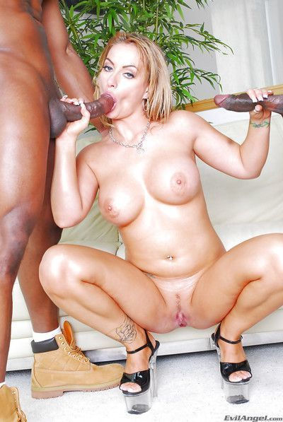 Busty blonde slut is into interracial threesome with black guys