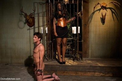 Gorgeous black dominatrix tramples and smothers cute slaveboy