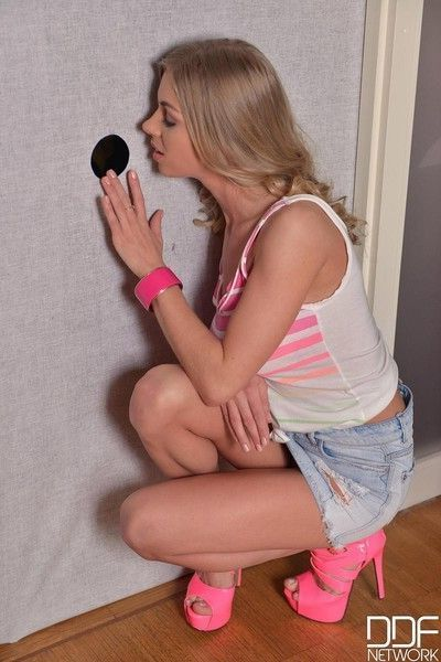 Blonde sucking a gloryhole dick