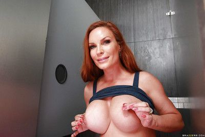 Busty MILF housewife Diamond Foxxx giving BJ at gloryhole in bathroom