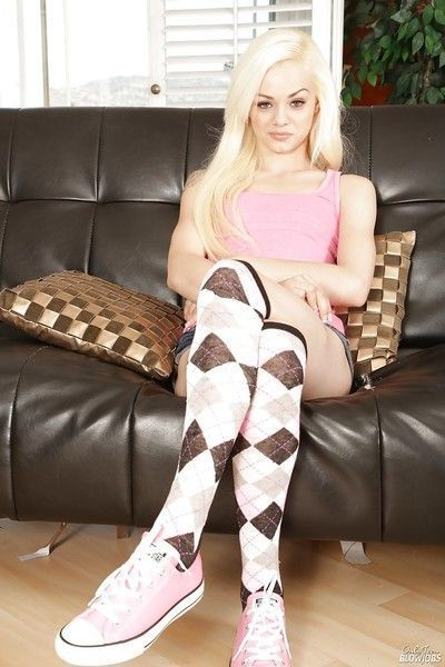 Petite platinum blond teen Elsa Jean poses seductively in argyle knee socks
