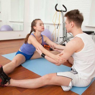 Curvy teen gymnast drilled in the gym
