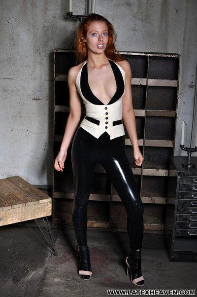 Kinky redhead teasing in black latex leggings