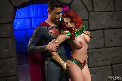 Chesty cosplay redhead Britney Amber taking a cumshot on her tongue