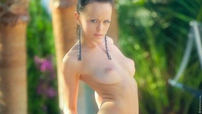 Oiled brunette nymph pees outdoors