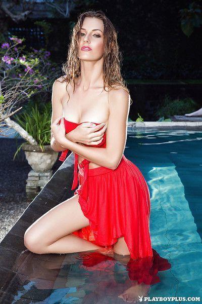 Glamorous model Jennifer Love is posing naked in the swimming pool