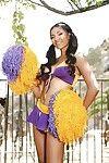 Latina cheerleader Sadie Santana giving a glimpse of her pussy in backyard