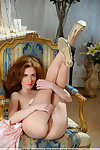 Tiny redhead Adel P stands naked after showing her ginger colored bush