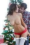Stocking attired August Ames giving blowjob in front of Christmas tree